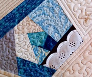 Set of four crazy quilt blue mug rugs with eyelet accents