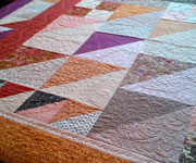 Pyramids and Plumes King quilt