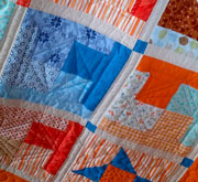 Orange and blue lap quilt