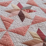 Star and pinwheel lap quilt dubbed 'Persian Lamb'